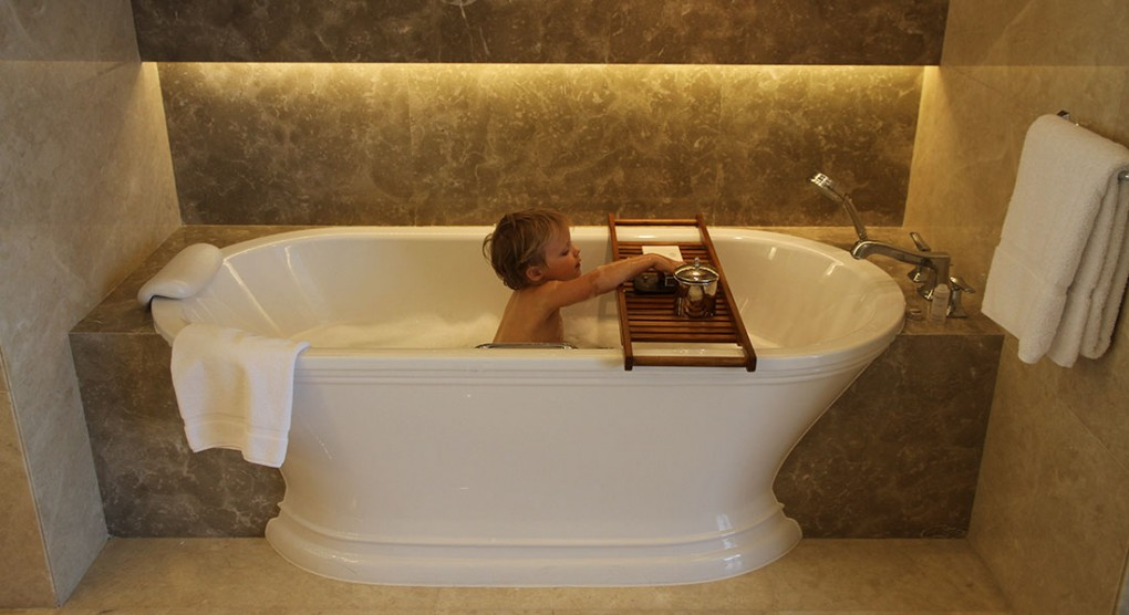 kid in bath tub at hotel Raffles Jakarta