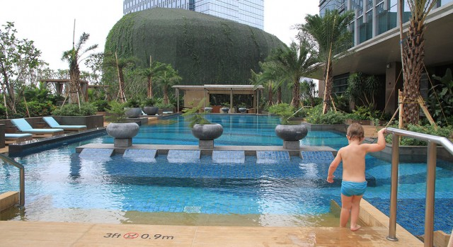 kid in swimming pool at hotel Raffles Jakarta