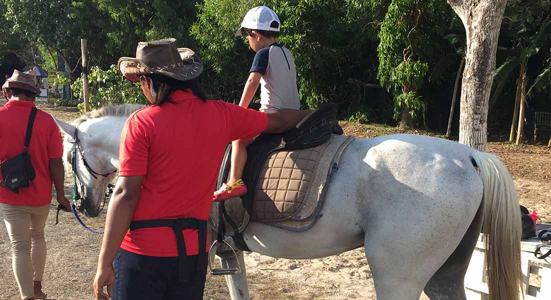 kids horse riding at hotel shangri-la Rasa Ria kota kinabalu