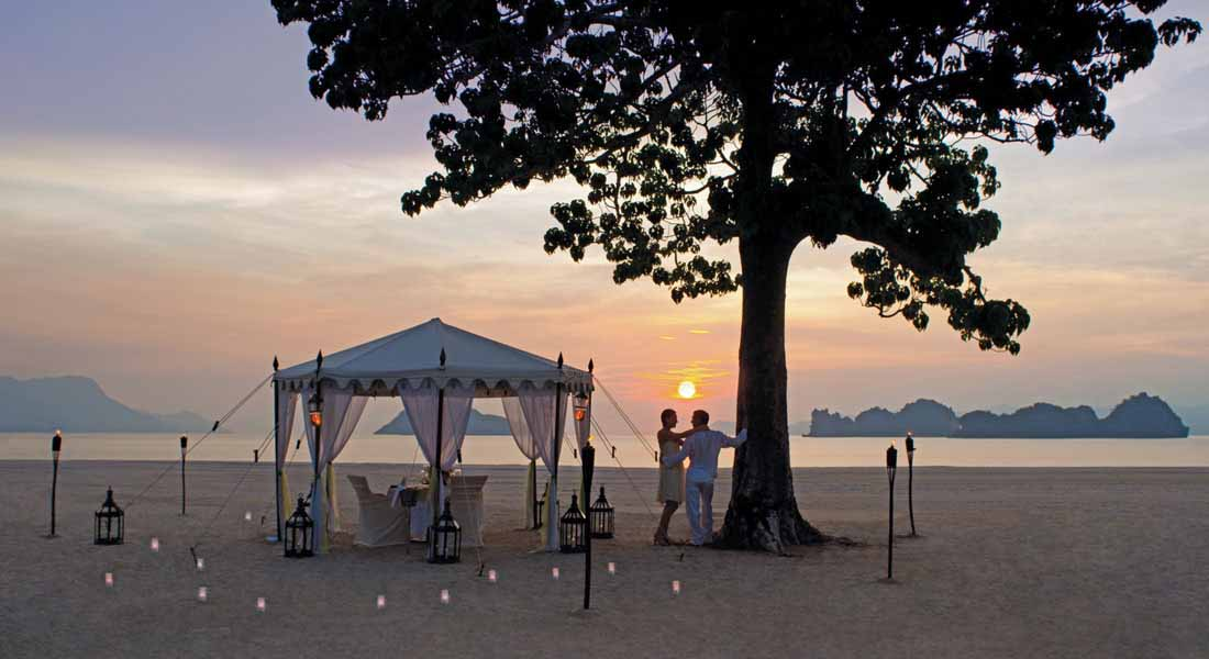 romantic dinners for parents on the beach at kid friendly hotel four seasons langkawi