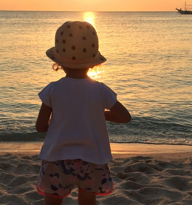 kid-standing-on-beach