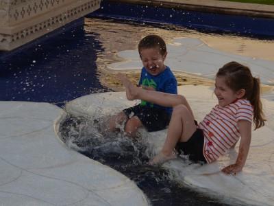 kids splashing on lotus