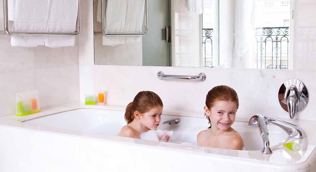 kids having fun in the bathrooms at hotel le bristol paris