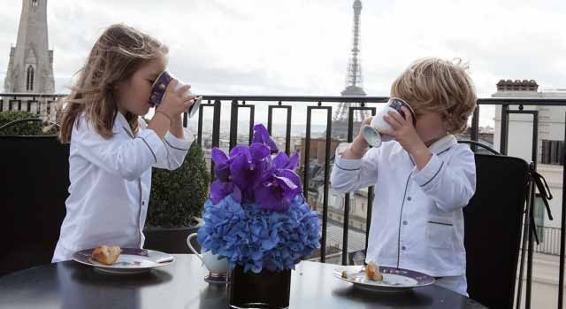 Children having breakfast at hotel Four Seasons Paris