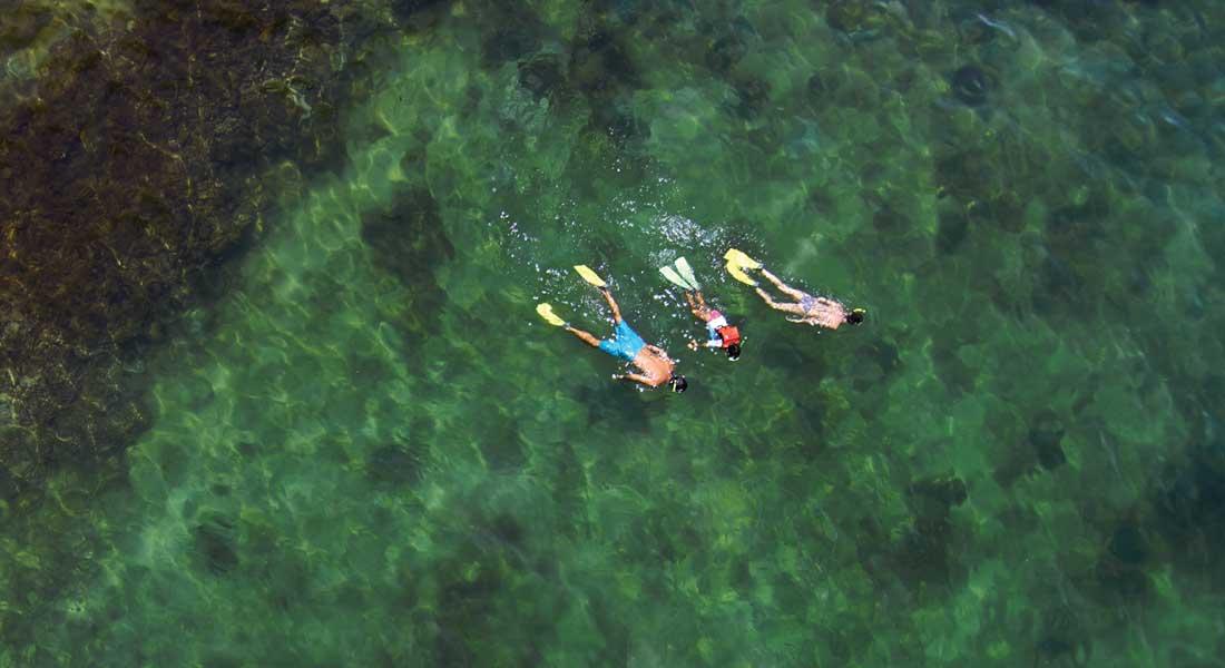family snorkeling at at hotel shangri-la tanjung aru kota kinabalu