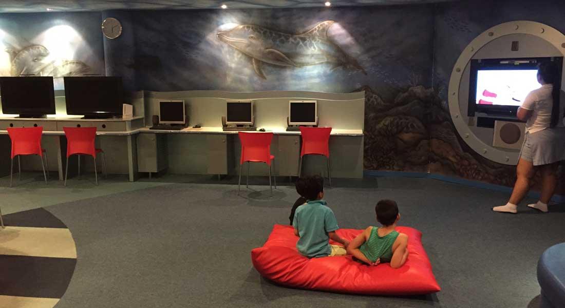 kids watching TV at kids' club at hotel shangri-la tanjung aru kota kinabalu
